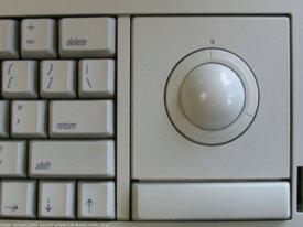 Recherche Track Ball pour Macintosh Portable