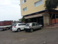 Immeuble avec Café au boulevard sur Oulfa 1