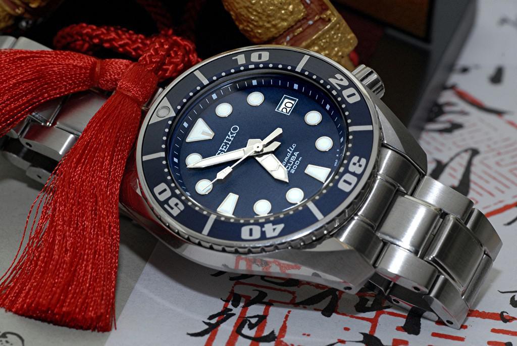 Choix montre pour quelqu'un qui n'y connait pas grand' chose en montres de plong 392808sumo