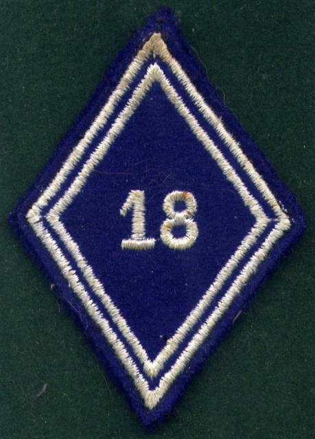 Quelques insignes du 18° 939851Bras181