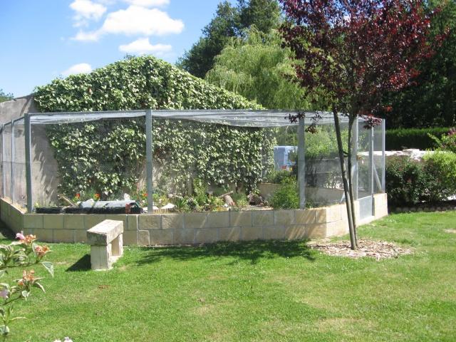 Recherche idées pour construire un enclos en parpaing 4419039321