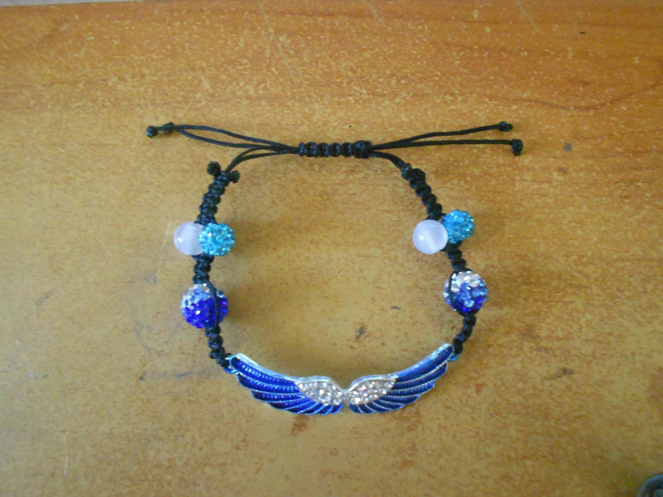 un bracelet en hommage a votre ange - Page 3 798201braceletkalan1