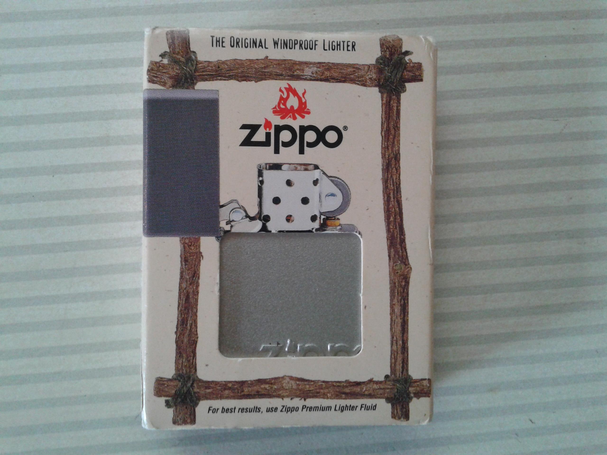 Les boites Zippo au fil du temps - Page 2 315248Windproof1