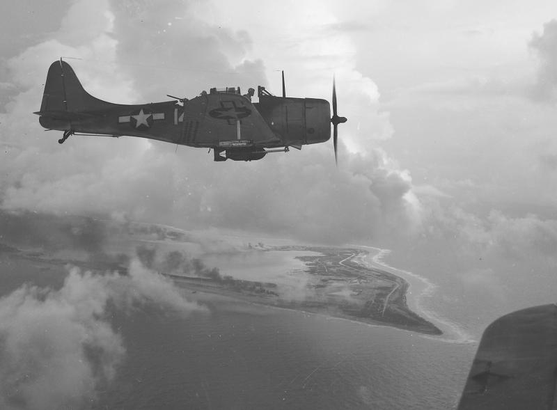 DOUGLAS DAUNTLESS 231726A_Douglas_SBD_Dive_Bomber_over_Wake_Island__1943